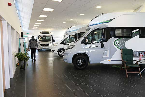 Man in motorhome showroom
